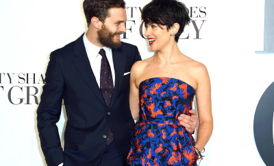 Jamie Dornan and wife Amelia Warner pose for photographers at the UK Premiere of Fifty Shades of Grey, at a central London cinema, Thursday, Feb. 12, 2015. (Photo by Jonathan Short/Invision/AP)
