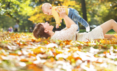 Autumn portrait of mother and baby
