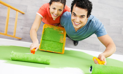 Above view of a cheerful couple painting the wall in green.   [url=http://www.istockphoto.com/search/lightbox/9786786][img]http://dl.dropbox.com/u/40117171/couples.jpg[/img][/url]