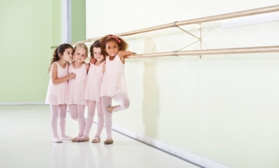 Little girls (4 years) in dance studio taking ballet lesson.