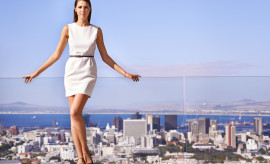Panoramic shot of a young businesswoman overlooking the city