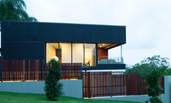 New stylish modern home exterior at dusk
