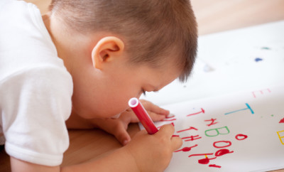 Little-boy-writing-his-first-letters-000017431345_Small