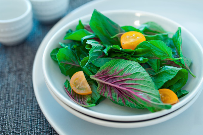 A salad of chinese spinach and heirloom cherry tomatoes.  Shallow dof