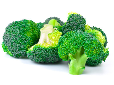 shot of sliced green broccoli on white background