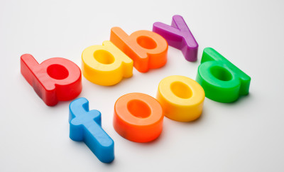 Refrigerator magnets spell out the word