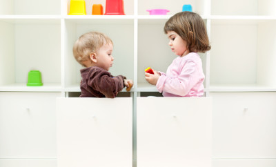 Cute little children having fun playing