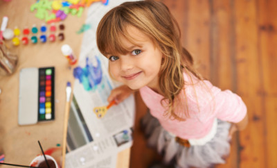 Shot of an adorable little girl doing arts and crafts