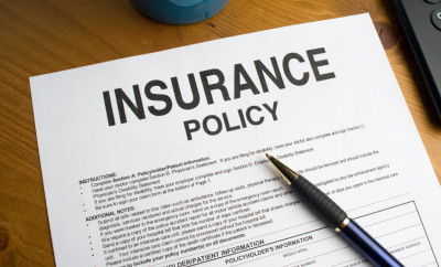 An-insurance-policy-on-a-desktop-000010851319_Small