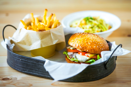 Lunch menu with classic american cheese burger, french fries and vegetable salad