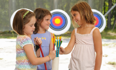 A group of girls at archery practice