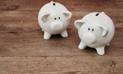 Two-piggy-banks-on-table-000068814499_Small