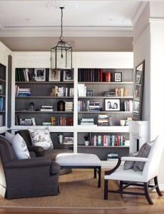 29-Cool-Built-In-Bookshelves-Ideas-With-grey-wooden-bookshelves-and-sofa-pillow-chair-and-candle-lantern-and-brown-rug-and-wooden-floor