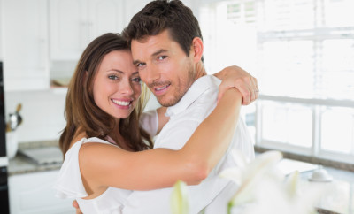 Loving-young-couple-embracing-at-home-000060561580_Small