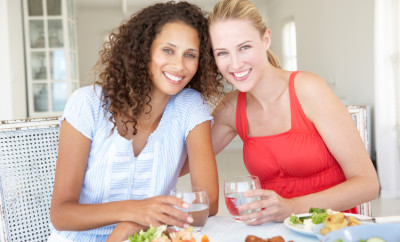 Two Young Women Enjoying Meal Together