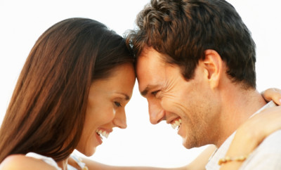 Profile view of romantic couple with heads together on white background