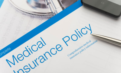 Health Insurance Policy brochure with paperwork. The included image can also be found in my portfolio. Image #31376536