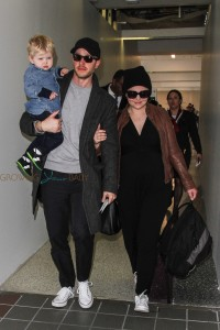 Pregnant-Ginnifer-Goodwin-and-Josh-Dallas-depart-LAX-with-their-Son-Oliver