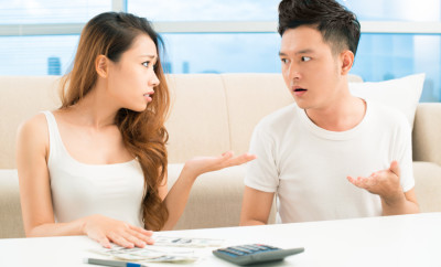 Image of a young couple having a quarrel about money