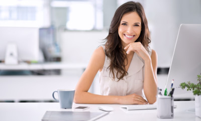 Shot of an attractive businesswoman sitting at her desk in an office