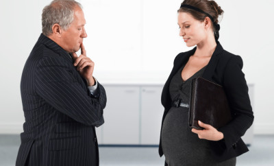 Boss and Pregnant Businesswoman