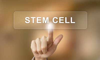 business hand pushing stem cell button on blurred background