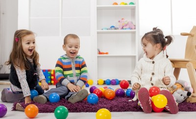 Cute kids playing in the room with toys