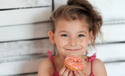Child. Cute girl with a donut