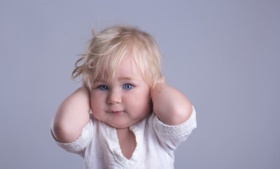 deaf baby blue eyes blonde long hair gray background