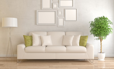 Modern living room with picture frame on wall