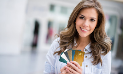 Woman holding credit cards at the shopping center