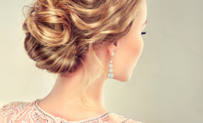 Beautiful girl light brown hair with an elegant wedding  hairstyle. View from back side.