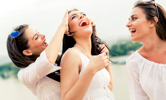 Cheerful women having fun outdoors and laughing happily