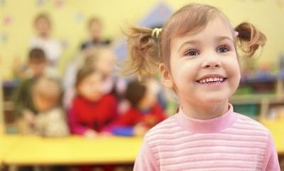 Little smiling girl in kindergarten
