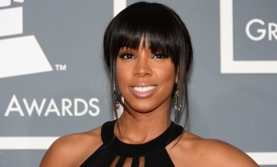 Singer Kelly Rowland arrives on the red carpet at the Staples Center for the 55th Grammy Awards in Los Angeles, California, February 10, 2013. AFP PHOTO Frederic J. BROWN        (Photo credit should read FREDERIC J. BROWN/AFP/Getty Images)
