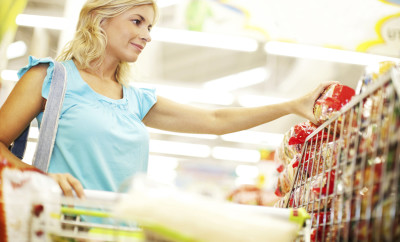 Blond attractive woman buying groceries in supermarket