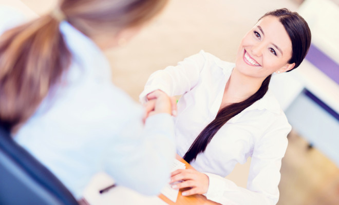Business woman in a job interview - you are hired!