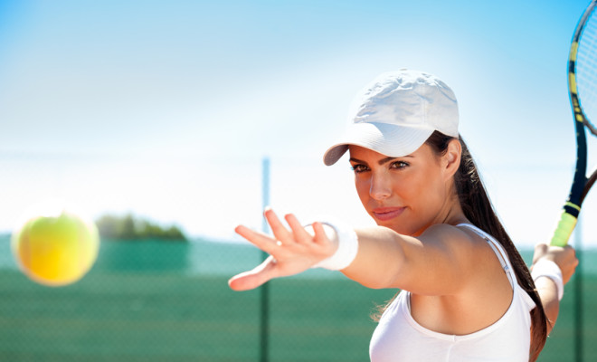 young female tennis player ready to hit ball