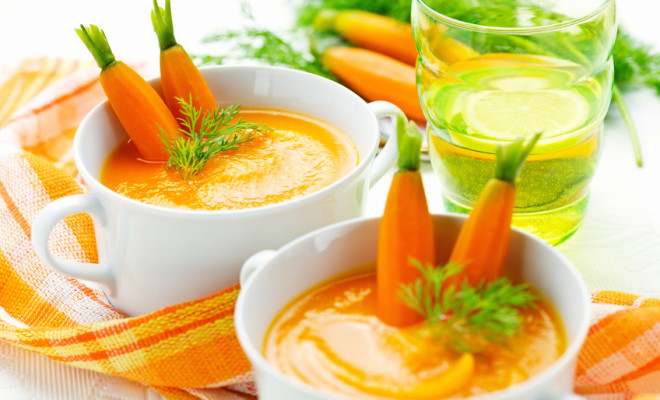 Healthy vegetarian soup puree with carrot and herbs