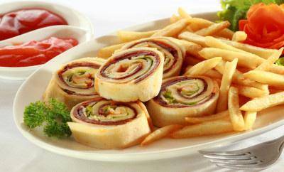 Spiral Sandwich Appetizers served with french fries