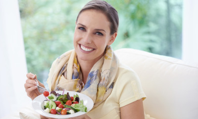 A young woman enjoying a delicious salad