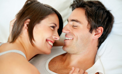 Closeup portrait of a happy young couple in a romantic mood in bedroom