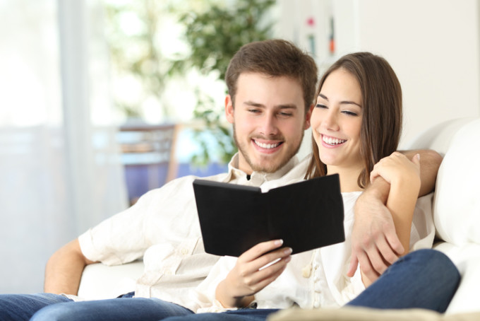 Couple reading a guide in an ebook