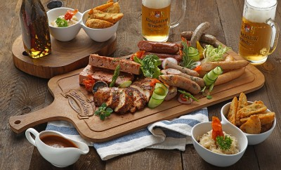 Grilled Platter for 4 with different Sausages, Meat, Sauerkraut, and Potato Wedges