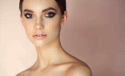 Studio shot of young beautiful woman. Professional make-up.