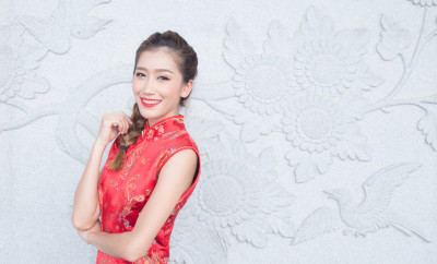 Beautiful asian woman with Traditional Chinese new year dress