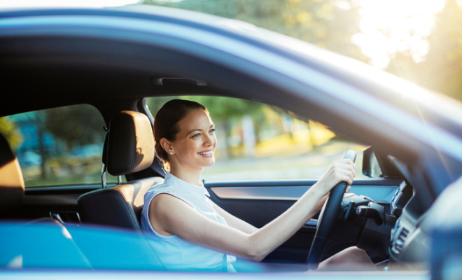 Close up photo of a businesswoman driving a car