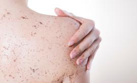 Body care, skin peeling. Massaging the back.