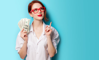 Woman wearing red glasses with money in her hand