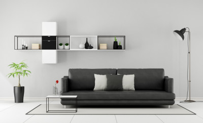 Minimalist living room with black sofa and sideboard on wall - 3D Rendering